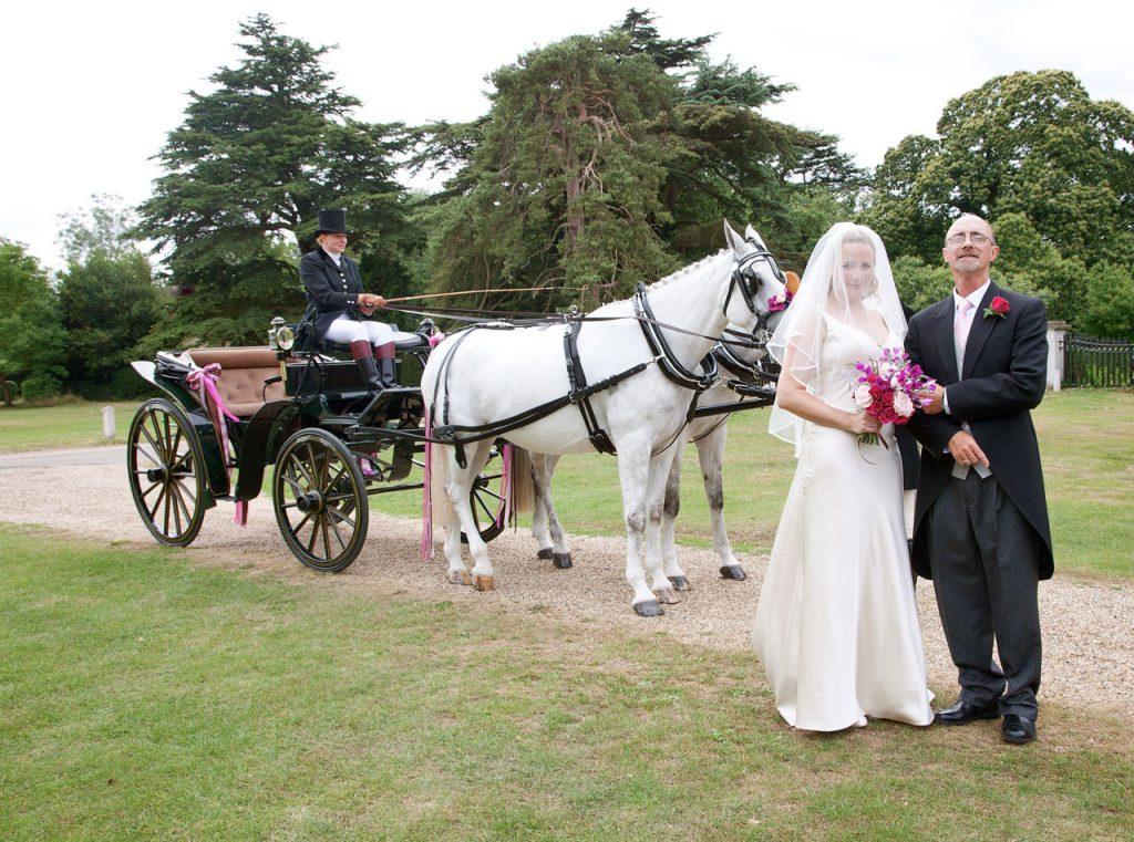 wedding carriage - wedding couple - old fashioned wedding